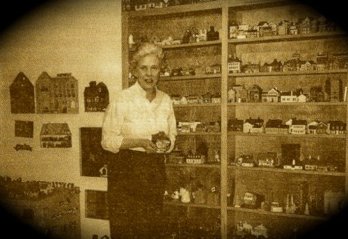 Photo of Pat Smith and miniature buildings 1996
