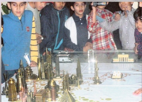 Photo of School Children viewing Architectural Models